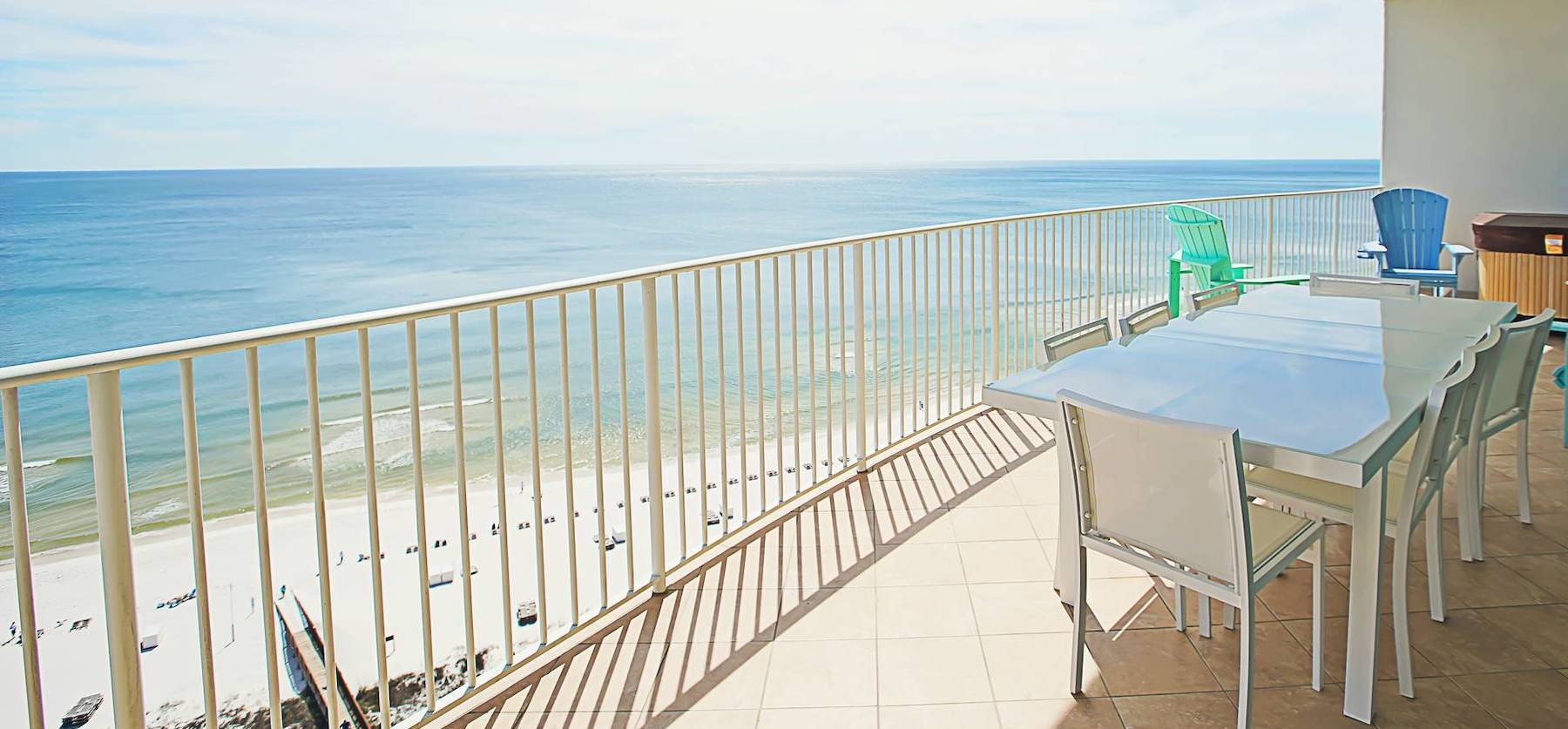 white patio table with chairs on condo patio at gulf shores resort over looking beach and gulf of mexico