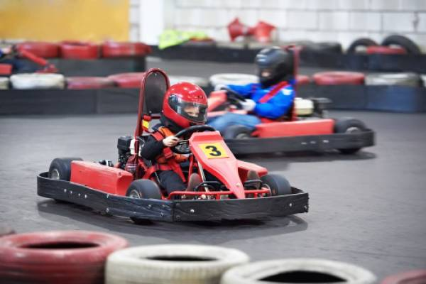 kids at a go kart park on a course